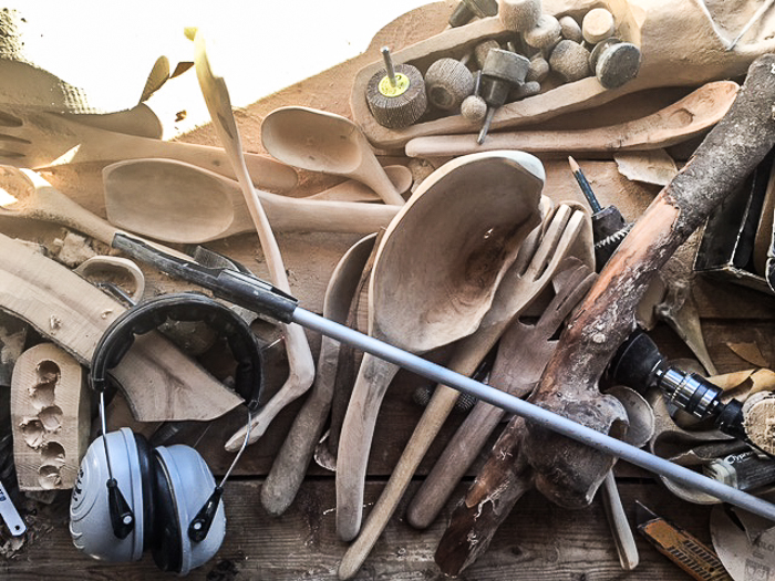work bench with wooden spoons